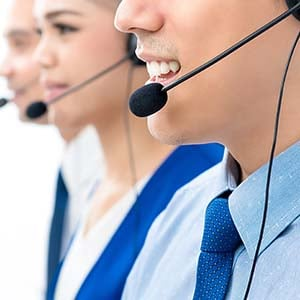 A team of workers on headsets taking insurance claims information