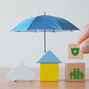 An umbrella covering wooden blocks in various shapes