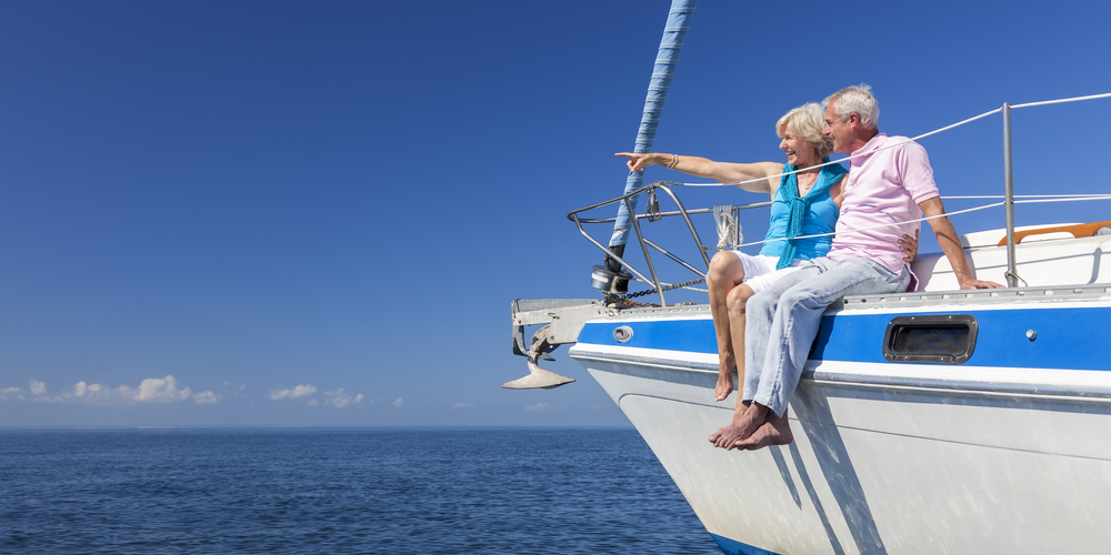 A retired couple enjoying time on their boat in Massachusetts